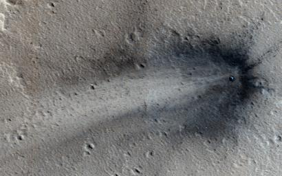 This image from NASA's Mars Reconnaissance Orbiter shows a new impact crater in Elysium Planitia.