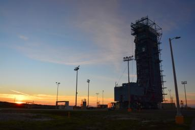 The sun sets behind Space Launch Complex 2, Vandenberg Air Force Base, California, where NASA's Soil Moisture Active Passive (SMAP) mission satellite is being prepared for liftoff. Launch is scheduled for Jan. 29.