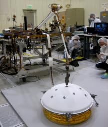 In the weeks after NASA's InSight mission reaches Mars in September 2016, the lander's arm will lift two science instruments off the deck and place them onto the ground.