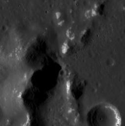Mercury's surface shown here by NASA's MESSENGER is located within a 73-km-diameter crater; the mounds are part of a larger central peak structure of the hosting crater.