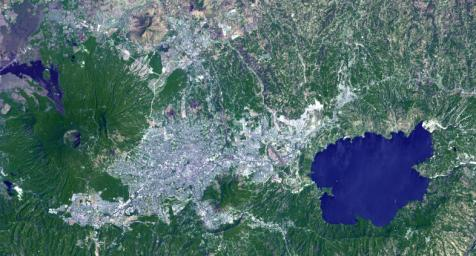 This image from NASA's Terra spacecraft shows Lake Ilopango, a crater lake which fills a volcanic caldera in central El Salvador, immediately east of the capital city San Salvador.