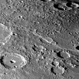 Lessing crater can be seen in the lower left of this image captured by NASA's MESSENGER spacecraft. Instead of the typical central peak found in a complex crater on Mercury, Lessing sports a central pit.