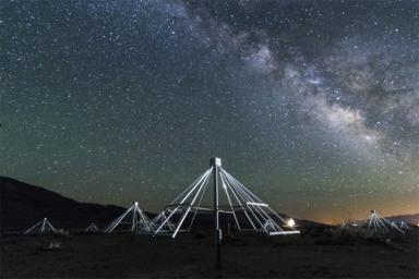 A nighttime shot shows some of the antennas of the Owens Valley Long Wavelength Array in California, with the center of our galaxy in the background.