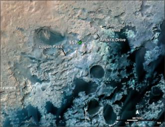 A green star marks the location of NASA's Curiosity Mars rover after a drive on the mission's 957th Martian day, or sol, (April 16, 2015). The map covers an area about 1.25 miles (2 kilometers) wide.