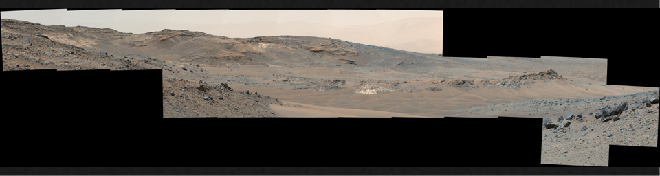 This April 16, 2015, panorama from the Mast Camera on NASA's Curiosity Mars rover shows a detailed view toward two areas, 'Mount Shields' and 'Logan Pass,' on lower Mount Sharp, chosen for close-up inspection in subsequent weeks.