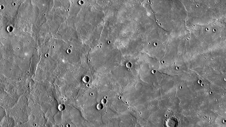 Mercury's northern region is dominated by expansive smooth plains, created by huge amounts of volcanic material flooding across Mercury's surface in the past, as seen by NASA's MESSENGER spacecraft.