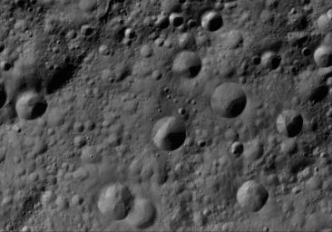 This image of Gegania AV-L-09, from the atlas of the giant asteroid Vesta, was created from images taken as NASA's Dawn mission flew around the object, also known as a protoplanet.