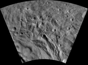 This image of Justina AV-L-29, from the atlas of the giant asteroid Vesta, was created from images taken as NASA's Dawn mission flew around the object, also known as a protoplanet.