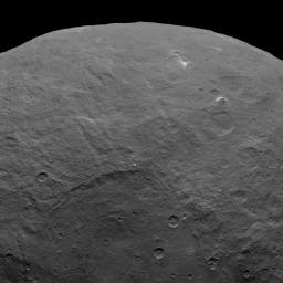 NASA's Dawn spacecraft took this image on June 6, 2015, which includes an intriguing pyramid-shaped mountain protruding from a relatively smooth area in the upper right.