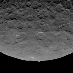 This image, taken by NASA's Dawn spacecraft on June 14, 2015, shows an intriguing mountain on dwarf planet Ceres protruding from a relatively smooth area.