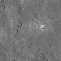 This image, taken June 6, 2015 by NASA's Dawn spacecraft, shows Haulani crater on Ceres from an altitude of 2,700 miles (4,400 kilometers) with a resolution of 1,400 feet (410 meters) per pixel. North on Ceres is toward upper right.