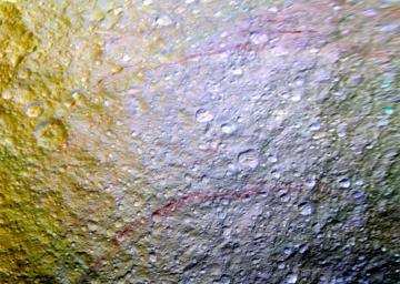 Unusual arc-shaped, reddish streaks cut across the surface of Saturn's ice-rich moon Tethys in this enhanced-color mosaic from NASA's Cassini spacecraft.