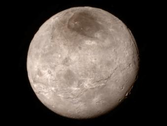 A swath of cliffs and troughs stretches about 600 miles (1,000 kilometers) on Pluto's largest moon Charon are revealed in this image from NASA'as New Horizon's spacecraft, taken late on July 13, 2015.
