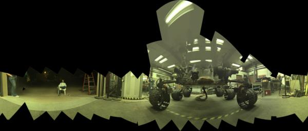 This view of a test rover at NASA's Jet Propulsion Laboratory, Pasadena, California, results from advance testing of arm positions and camera pointings for taking a low-angle self-portrait of NASA's Curiosity Mars rover.