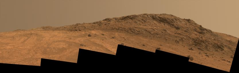 This Martian scene from NASA's Mars rover Opportunity shows contrasting textures and colors of 'Hinners Point,' at the northern edge of 'Marathon Valley,' and swirling reddish zones on the valley floor to the left.