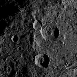 This image, taken by NASA's Dawn spacecraft, shows the surface of dwarf planet Ceres from an altitude of 915 miles (1,470 kilometers). The image, with a resolution of 450 feet (140 meters) per pixel, was taken on August 24, 2015.