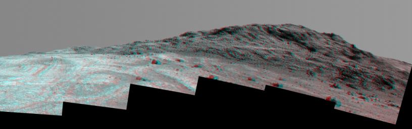This 3-D stereo view from NASA's Mars rover Opportunity shows contrasting textures and colors of 'Hinners Point,' at the northern edge of 'Marathon Valley,' and swirling reddish zones on the valley floor to the left.