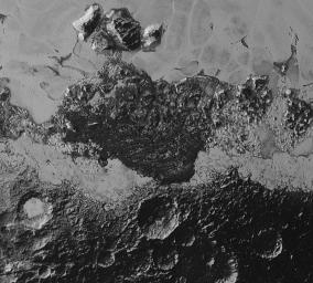 This image from NASA's New Horizons includes dark, ancient heavily cratered terrain, bright, smooth geologically young terrain, assembled masses of mountains, and an enigmatic field of dark, aligned ridges that resemble dunes.