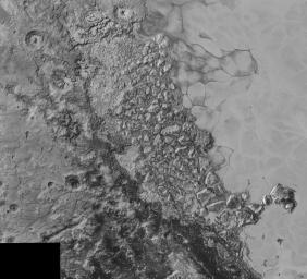 In the center of this 300-mile (470-kilometer) wide image of Pluto from NASA's New Horizons spacecraft is a large region of jumbled, broken terrain on the northwestern edge of the vast, icy plain informally called Sputnik Planum, to the right.