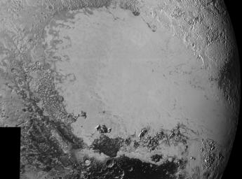 Mosaic of high-resolution images of Pluto, transmitted by NASA's New Horizons spacecraft from Sept. 5 to 7, 2015. The image is dominated by the informally-named icy plain Sputnik Planum, the smooth, bright region across the center.