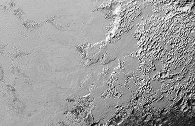 Ice (probably frozen nitrogen) that appears to have accumulated on the uplands on the right side of this image from NASA's New Horizons, is draining from Pluto's mountains onto the informally named Sputnik Planum.
