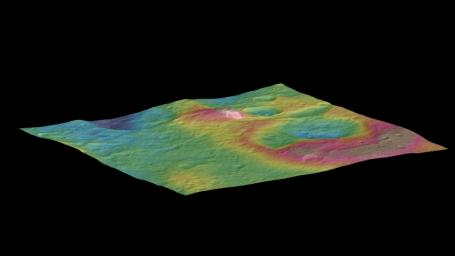 This view, made using images taken by NASA's Dawn spacecraft, features a tall conical mountain on Ceres. Elevations span a range of about 5 miles (8 kilometers) from the lowest places in this region to the highest terrains.