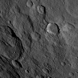 This image, taken by NASA's Dawn spacecraft, shows a portion of the southern hemisphere of dwarf planet Ceres from an altitude of 915 miles (1,470 kilometers). Toharu crater, named for the Pawnee god of food and vegetation, can be seen at left.