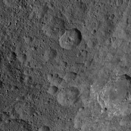 This image, taken by NASA's Dawn spacecraft, shows the surface of dwarf planet Ceres at mid-latitudes from an altitude of 915 miles (1,470 kilometers). The image was taken on Sept. 21, 2015, and has a resolution of 450 feet (140 meters) per pixel.