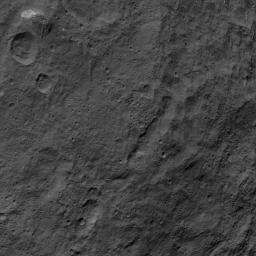 This image, taken by NASA's Dawn spacecraft, shows the surface of dwarf planet Ceres from an altitude of 915 miles (1,470 kilometers) around mid-latitudes. The unusual mountain Ahuna Mons is featured here.