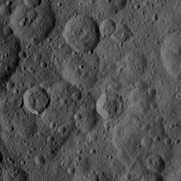 The craters in the image, taken Oct. 1, 2015 from NASA's Dawn spacecraft, are characterized by different degrees of freshness, reflecting different ages. The sharply defined crater to right of center is named Takel.