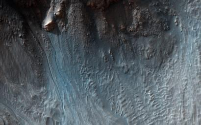 Sometimes a central pit forms inside some Martian craters, especially when there's substantial ground ice. Such is the case in this observation from NASA's Mars Reconnaissance Orbiter spacecraft.