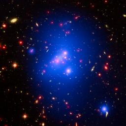 Astronomers have made the most detailed study yet of an extremely massive young galaxy cluster using three of NASA's Great Observatories. This rare galaxy cluster, located 10 billion light-years from Earth, is almost as massive as 500 trillion suns.