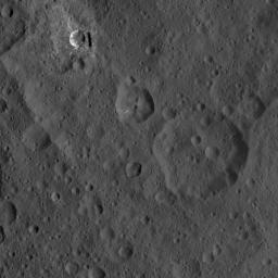 This image of Ceres, taken by NASA's Dawn spacecraft, shows three prominent craters located to the northeast of a terrace (the terrace feature being located at left in this image).