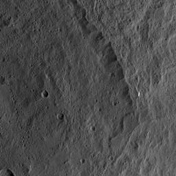 This view from NASA's Dawn spacecraft shows the rim of the large impact feature named Yalode in the southern mid-latitudes on dwarf planet Ceres. Linear, roughly parallel features are visible in the crater wall.