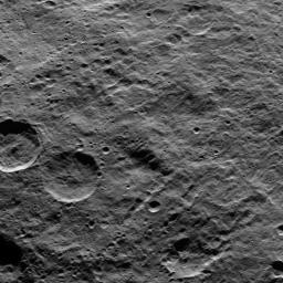 Part of the southern hemisphere on dwarf planet Ceres is seen in this image taken by NASA's Dawn spacecraft. Two prominent, similarly sized craters (at left) demonstrate how impact features become degraded over time.