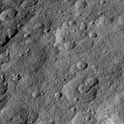 This view from NASA's Dawn spacecraft shows high northern latitudes on Ceres. Dawn acquired the image on Oct. 17, 2015, from an altitude of 915 miles (1,470 kilometers). It has a resolution of 450 feet (140 meters) per pixel.