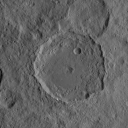 This image, taken on Oct. 6, 2015 from NASA's Dawn mission, shows the 52-mile-wide (84 kilometer-wide) crater on Ceres named Gaue. This medium-sized basin has a relatively fresh rim with terraced walls and a smooth floor.