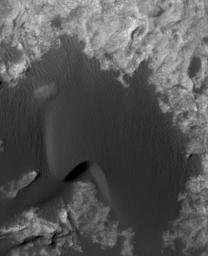 This is a frame from an animation that flips back and forth between views taken in 2010 and 2014 of a Martian sand dune at the edge of Mount Sharp, documenting dune activity.