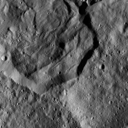 This image from NASA's Dawn spacecraft, taken Dec. 19, 2015, shows part of Messor Crater, at northern mid-latitudes on Ceres. The scene shows an older crater in which a large lobe-shaped flow partly covers the northern (top) part of the crater floor.