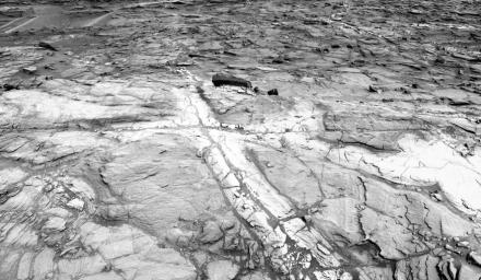This view from NASA's Curiosity Mars rover shows an example of discoloration closely linked to fractures in the Stimson formation sandstone on lower Mount Sharp. The pattern is evident along two perpendicular fractures.