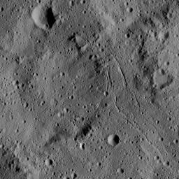 This view from NASA's Dawn spacecraft captures gently curving canyons amid cratered plains on Ceres. The image is centered at approximately 31 degrees south latitude, 259 degrees east longitude, just north of the large crater Urvara.
