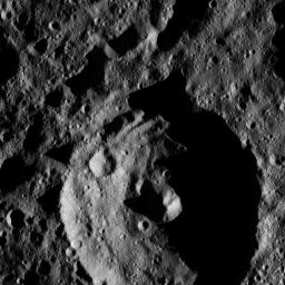 This view from NASA's Dawn spacecraft shows a crater in the southern hemisphere of Ceres with a prominent central peak. The image is centered at approximately 63 degrees south latitude, 143 degrees east longitude. Dawn captured the scene on Dec. 24, 2015.