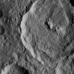 Tupo Crater on Ceres is seen in this view from NASA's Dawn spacecraft. This crater, located in the southern hemisphere of Ceres, was named for a Polynesian god of turmeric. Dawn captured the scene on Dec. 24, 2015.