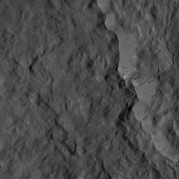 This image from NASA's Dawn spacecraft shows the western rim of Occator Crater. Several small, bright patches of material can be seen along the rim.