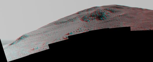 This stereo view from NASA's Mars Exploration Rover Opportunity looks upward at 'Knudsen Ridge' on the southern edge of 'Marathon Valley' from inside the valley. You need 3-D glasses to view this image.