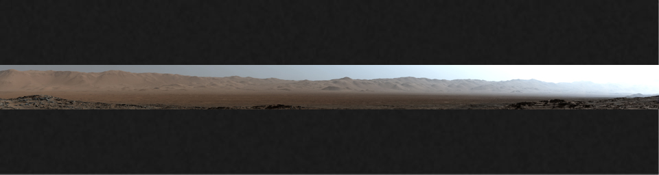 This early-morning view from NASA's Curiosity Mars rover covers a field of view of about 130 degrees of the inner wall of Gale Crater. The rover's location was on the 'Naukluft Plateau' of lower Mount Sharp.