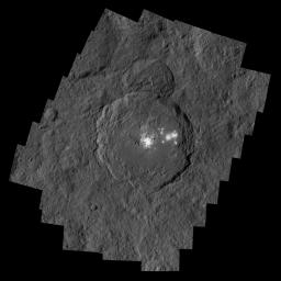 NASA's Dawn spacecraft captured Occator Crater, containing the brightest area on Ceres; this closeup reveals a dome in a smooth-walled pit in the bright center of the crater.