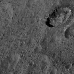 This image of Ceres from NASA's Dawn spacecraft was taken at an oblique viewing angle relative to the surface. The crater to the upper right is named Juling which displays prominent spurs of compacted material along its walls.