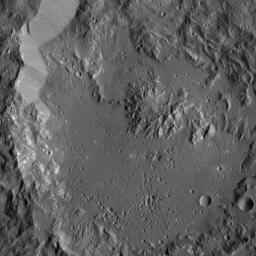 This image, taken by NASA's Dawn spacecraft, shows Ikapati Crater with its complex of central peaks on Ceres. Several groupings of roughly parallel fractures are present in smooth areas of the crater floor.