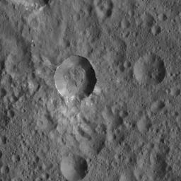 This view from NASA's Dawn spacecraft shows an unnamed Cerean crater that is surrounded by a smooth blanket of ejecta, including bright material. Both the area around the crater and its floor are peppered with giant boulders.